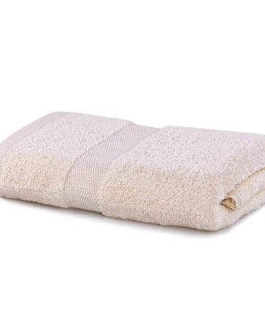 Svetlobéžový uterák DecoKing Marina, 50 × 100 cm